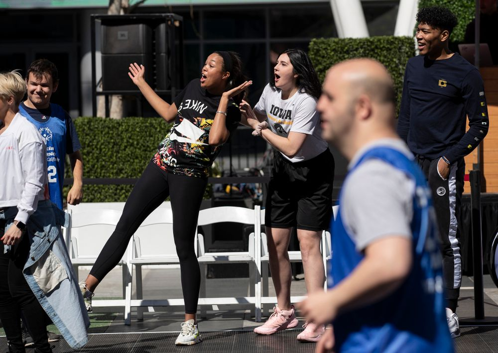 Iowa Hawkeyes forward Megan Gustafson (10) and UCONNÕs Napheesa Collier cheer on the athletes during a Special Olympics Event Friday, April 12, 2019 in the XBOX Plaza at LA Live.  (Brian Ray/hawkeyesports.com)