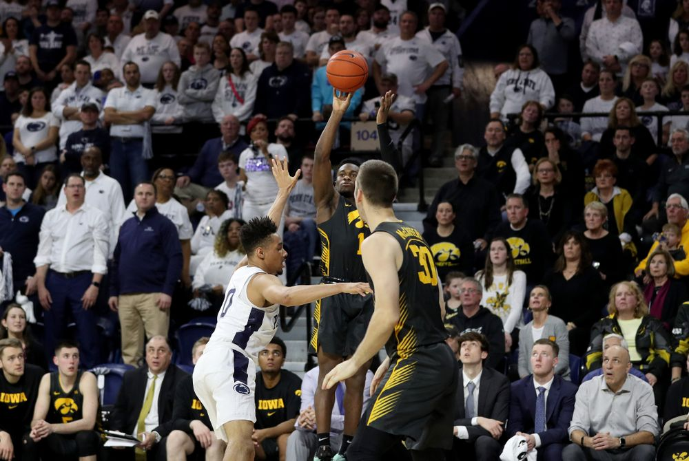 Iowa Hawkeyes guard Joe Toussaint (1) knocks down a three point basket against Penn State Saturday, January 4, 2020 at the Palestra in Philadelphia. (Brian Ray/hawkeyesports.com)