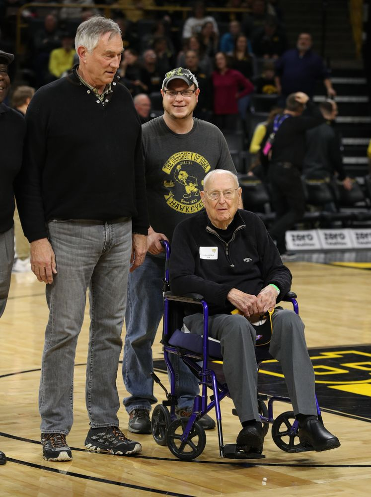 Former Iowa Hawkeye letterman Ned Postels is recognized during half-time against the Ohio State Buckeyes Saturday, January 12, 2019 at Carver-Hawkeye Arena. (Brian Ray/hawkeyesports.com)