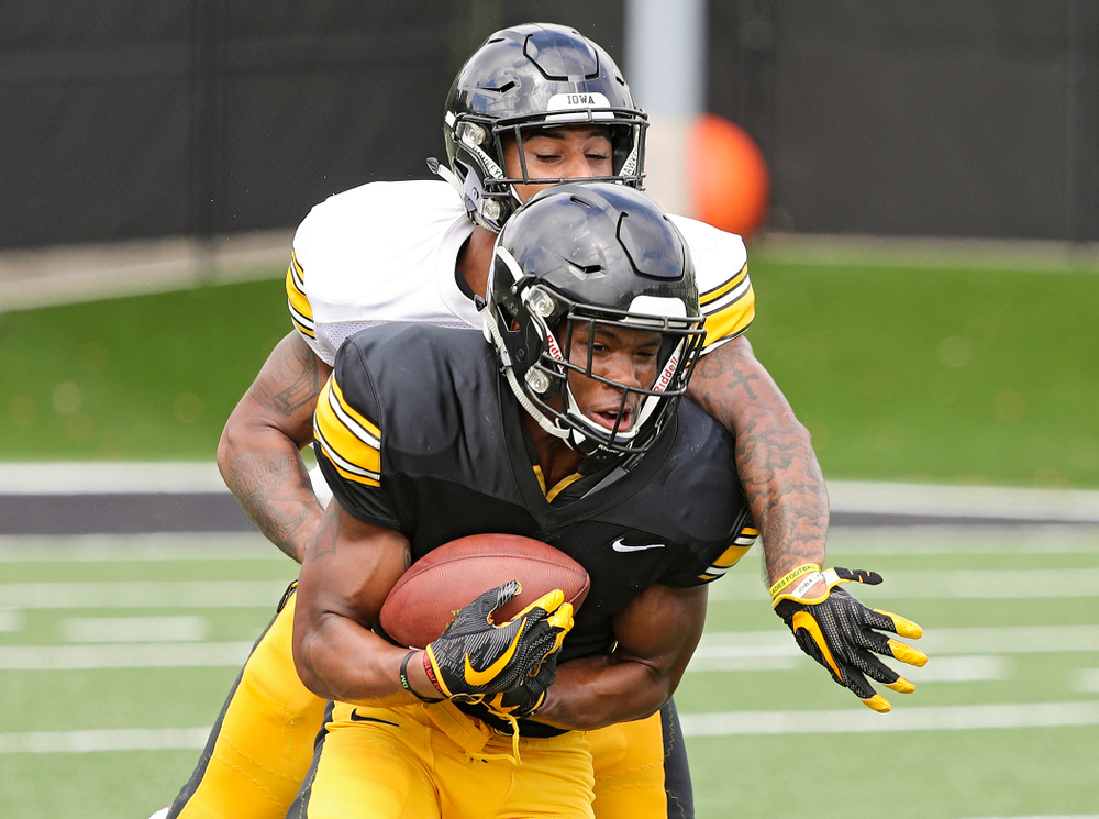Iowa Hawkeyes wide receiver Tyrone Tracy Jr. (3) pulls in a pass as defensive back Geno Stone (9) defends during Fall Camp Practice No. 10 at the Hansen Football Performance Center in Iowa City on Tuesday, Aug 13, 2019. (Stephen Mally/hawkeyesports.com)