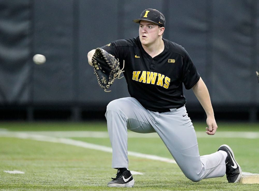 Iowa Hawkeyes first baseman Peyton Williams (45) pulls in a throw during practice at the Hansen Football Performance Center in Iowa City on Friday, January 24, 2020. (Stephen Mally/hawkeyesports.com)