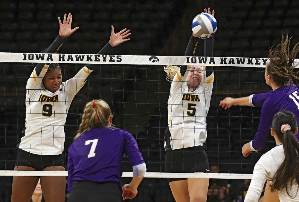 Iowa's Meghan Buzzerio (5) blocks a shot as Amiya Jones (9) looks on during their Big Ten/Pac-12 Challenge match at Carver-Hawkeye Arena in Iowa City on Saturday, Sep 7, 2019. (Stephen Mally/hawkeyesports.com)