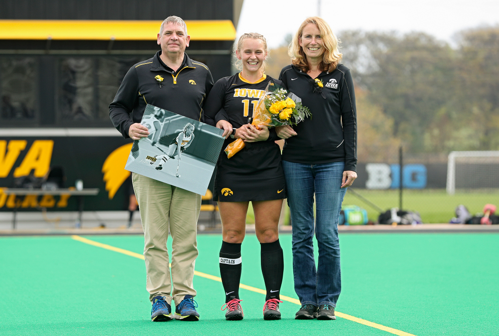Iowa's Katie Birch (11) in honored with her parents on Senior Day before their game at Grant Field in Iowa City on Saturday, Oct 26, 2019. (Stephen Mally/hawkeyesports.com)