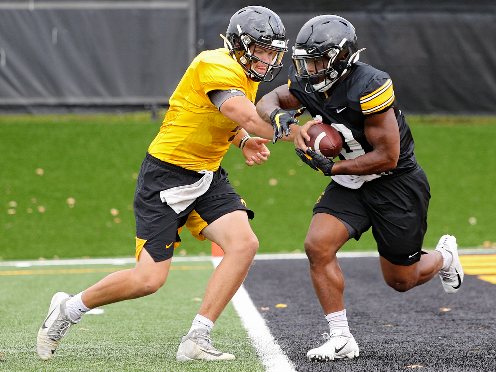Iowa Hawkeyes quarterback Nate Stanley (4) hands the ball off to running back Mekhi Sargent (10) during Fall Camp Practice No. 15 at the Hansen Football Performance Center in Iowa City on Monday, Aug 19, 2019. (Stephen Mally/hawkeyesports.com)