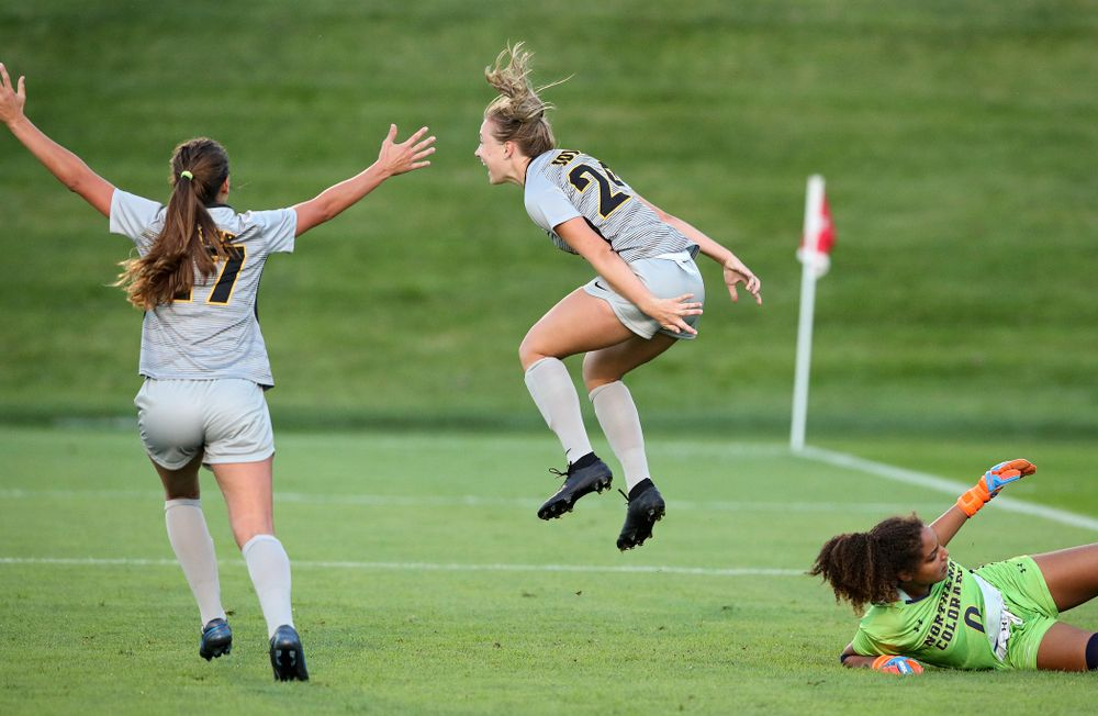 Iowa defender Sara Wheaton (24) celebrates with defender Hannah Drkulec (17) after scoring a goal during the first half of their match at the Iowa Soccer Complex in Iowa City on Friday, Sep 13, 2019. (Stephen Mally/hawkeyesports.com)