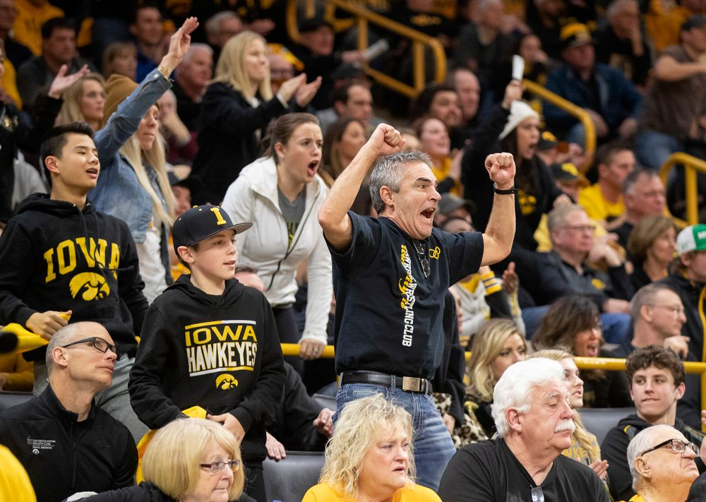 Iowa fans cheer on Kaleb Young in his 157-pound match during their dual at Carver-Hawkeye Arena in Iowa City on Friday, January 31, 2020. (Stephen Mally/hawkeyesports.com)