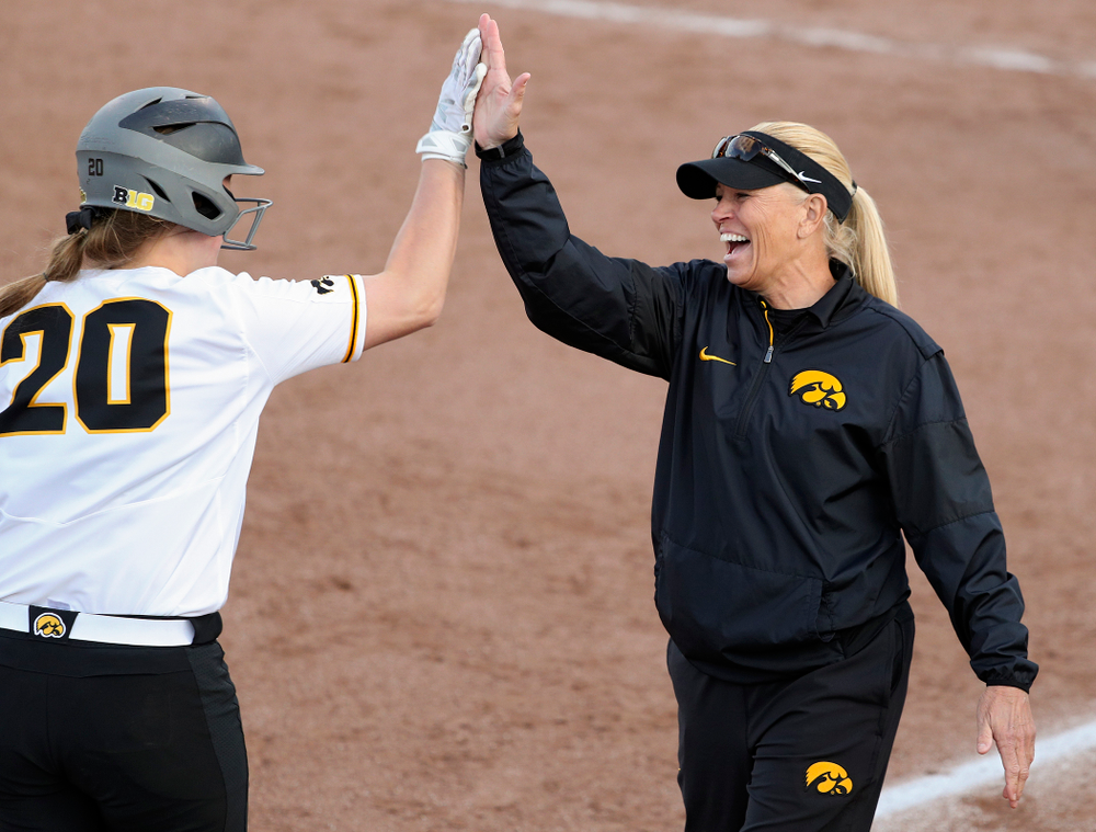 Iowa designated player Miranda Schulte (20) gets a high-five from head coach Renee Gillispie after hitting a home run during the sixth inning of their game against Ohio State at Pearl Field in Iowa City on Friday, May. 3, 2019. (Stephen Mally/hawkeyesports.com)