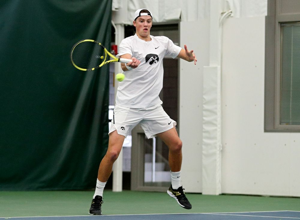 Iowa's Joe Tyler returns a shot during his doubles match at the Hawkeye Tennis and Recreation Complex in Iowa City on Sunday, February 16, 2020. (Stephen Mally/hawkeyesports.com)