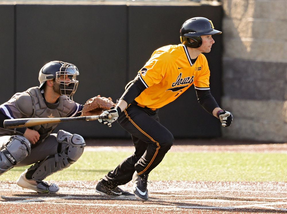 Iowa Hawkeyes center fielder Ben Norman (9) hits an RBI single during the first inning of their game at Duane Banks Field in Iowa City on Tuesday, Apr. 2, 2019. (Stephen Mally/hawkeyesports.com)