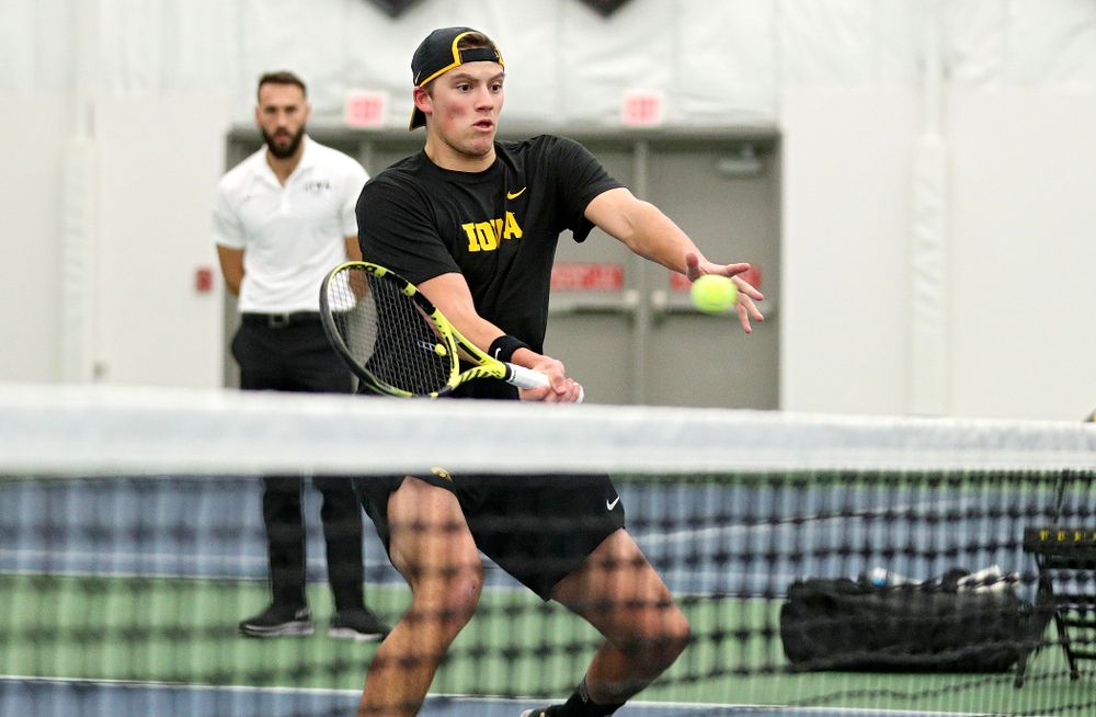 Iowa's Joe Tyler returns a shot during his doubles match at the Hawkeye Tennis and Recreation Complex in Iowa City on Thursday, January 16, 2020. (Stephen Mally/hawkeyesports.com)