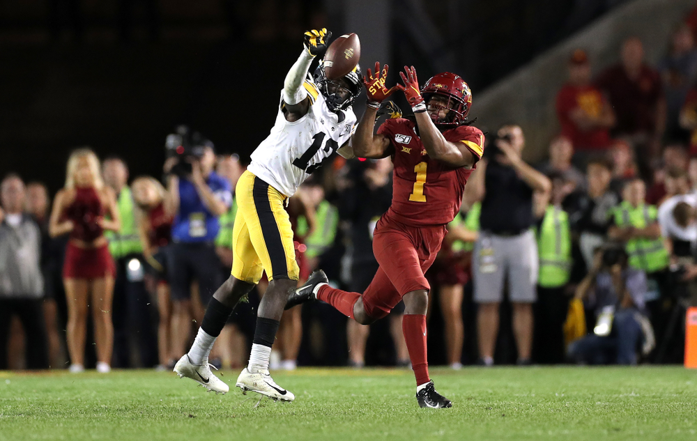 Iowa Hawkeyes defensive back D.J. Johnson (12) breaks up a pass  against the Iowa State Cyclones Saturday, September 14, 2019 in Ames, Iowa. (Brian Ray/hawkeyesports.com)
