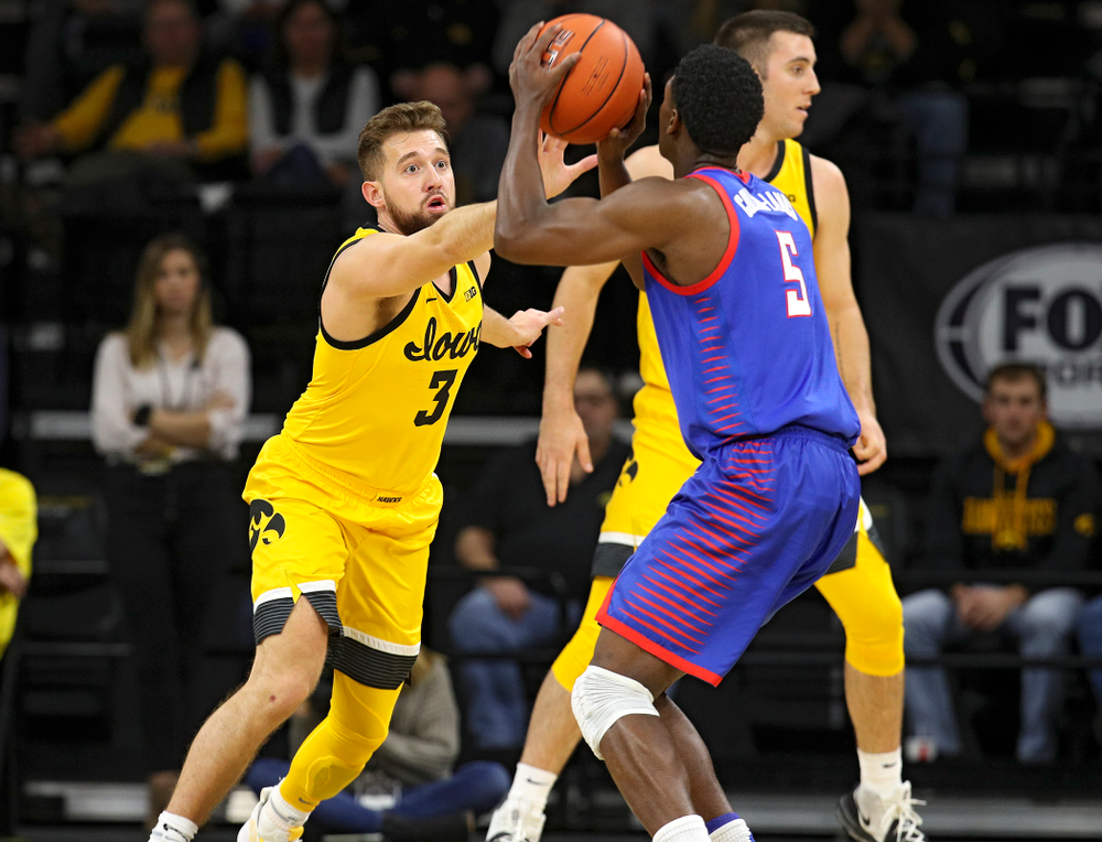 Iowa Hawkeyes guard Jordan Bohannon (3) defends during the first half of their game at Carver-Hawkeye Arena in Iowa City on Monday, Nov 11, 2019. (Stephen Mally/hawkeyesports.com)