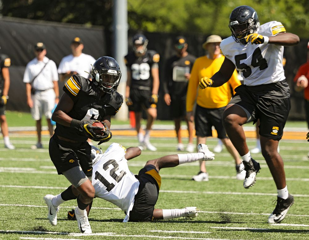 Iowa Hawkeyes wide receiver Ihmir Smith-Marsette (6) pulls in a pass around defensive back D.J. Johnson (12) and defensive tackle Daviyon Nixon (54) during Fall Camp Practice No. 7 at the Hansen Football Performance Center in Iowa City on Friday, Aug 9, 2019. (Stephen Mally/hawkeyesports.com)