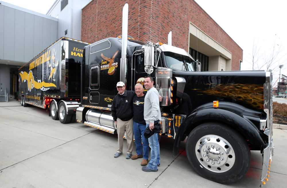 TanTara Transportation Corporation President Mike Riggan and operations manager Jeff Riggan stand with Iowa Football head equipment manager Greg Morris before departing for Tampa, Florida Friday, December 21, 2018 at the Hansen Football Performance Center. (Brian Ray/hawkeyesports.com)