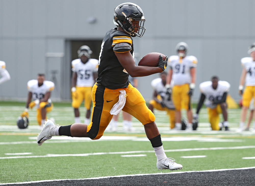 Iowa Hawkeyes running back Ivory Kelly-Martin (21) scores a touchdown during Fall Camp Practice No. 11 at the Hansen Football Performance Center in Iowa City on Wednesday, Aug 14, 2019. (Stephen Mally/hawkeyesports.com)