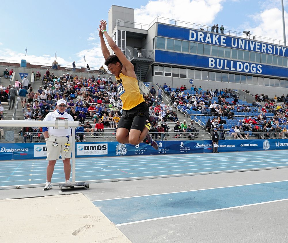 Iowa's James Carter makes a jump in the men's triple jump event during the second day of the Drake Relays at Drake Stadium in Des Moines on Friday, Apr. 26, 2019. (Stephen Mally/hawkeyesports.com)