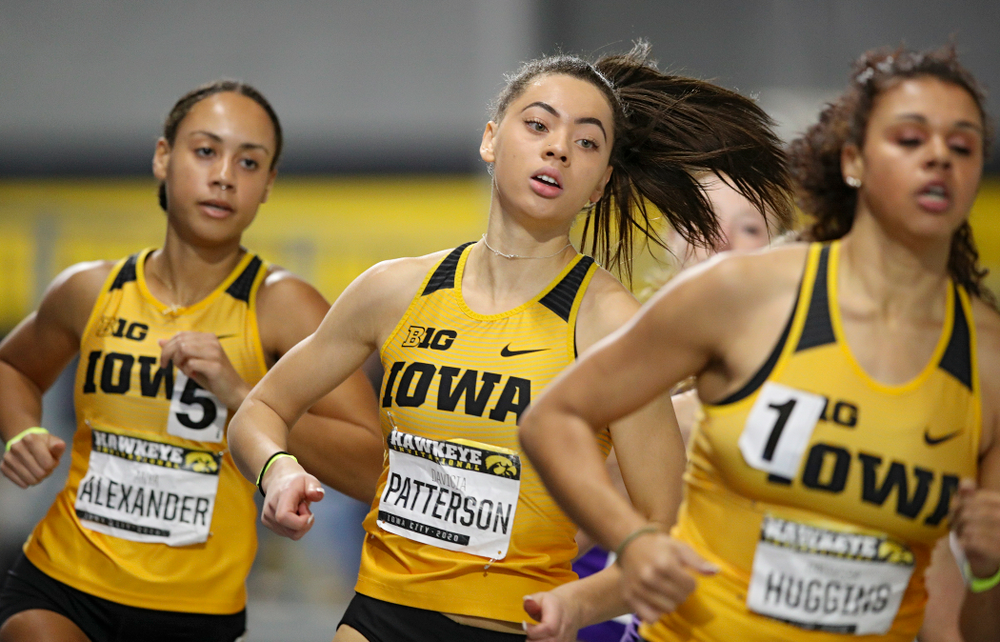 Iowa's Davicia Patterson (center) runs the women's 600 meter run event between Anaya Alexander (left) and Dallyssa Huggins during the Hawkeye Invitational at the Recreation Building in Iowa City on Saturday, January 11, 2020. (Stephen Mally/hawkeyesports.com)