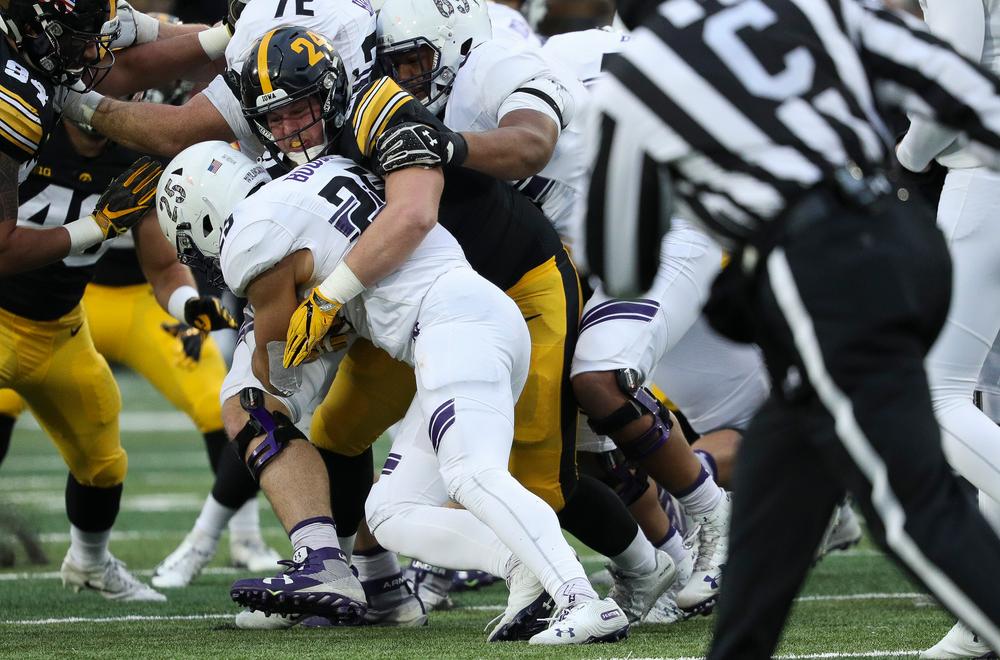 Iowa Hawkeyes defensive lineman Brady Reiff (91) makes a tackle during a game against Northwestern at Kinnick Stadium on November 10, 2018. (Tork Mason/hawkeyesports.com)