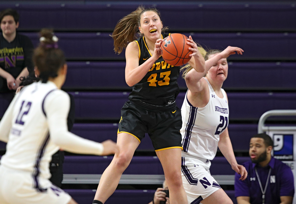 Iowa Hawkeyes forward Amanda Ollinger (43) pulls down a rebound during the first quarter of their game at Welsh-Ryan Arena in Evanston, Ill. on Sunday, January 5, 2020. (Stephen Mally/hawkeyesports.com)