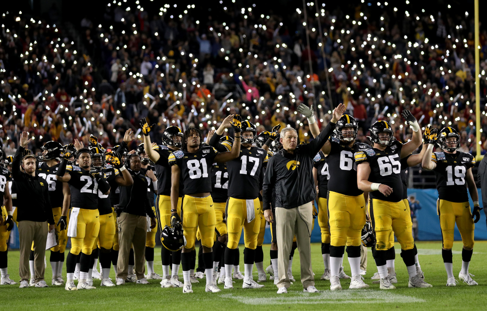 The Iowa Hawkeyes wave to the Stead Family ChildrenÕs Hospital at the end of the first quarter against USC in the Holiday Bowl Friday, December 27, 2019 at San Diego Community Credit Union Stadium.  (Brian Ray/hawkeyesports.com)
