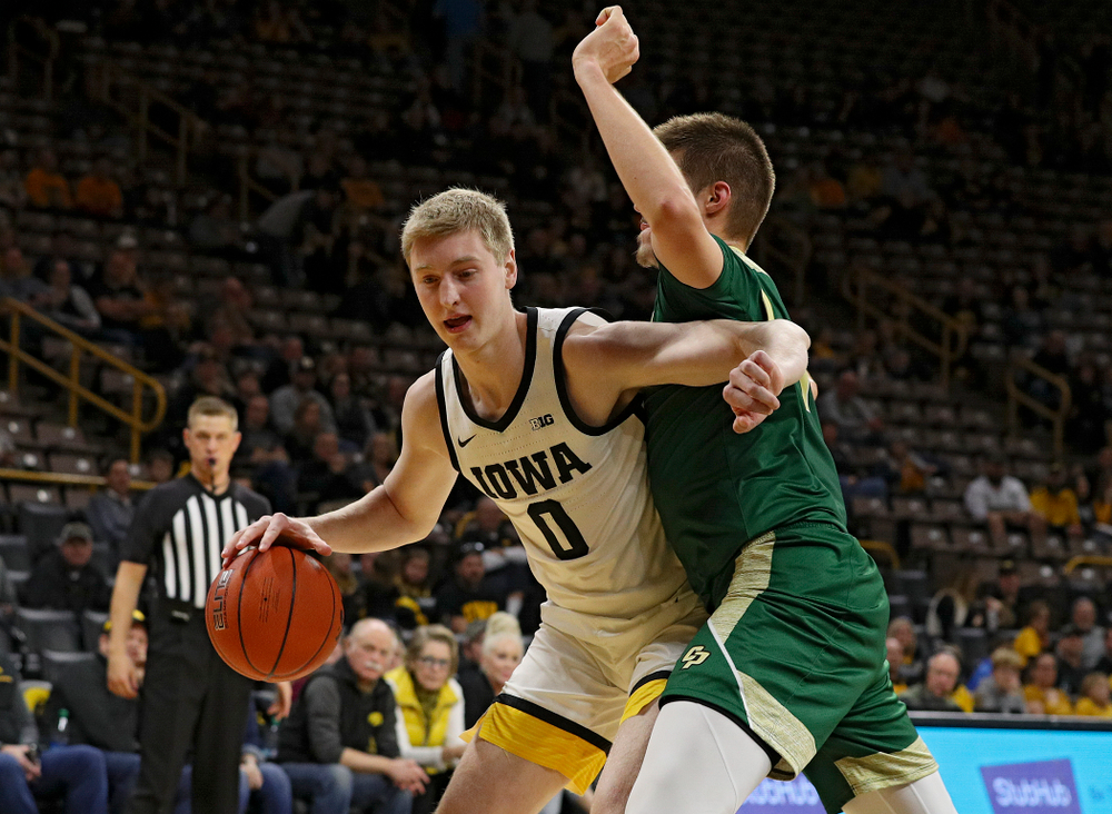 Iowa Hawkeyes forward Michael Baer (0) drives with the ball during the second half of their game at Carver-Hawkeye Arena in Iowa City on Sunday, Nov 24, 2019. (Stephen Mally/hawkeyesports.com)