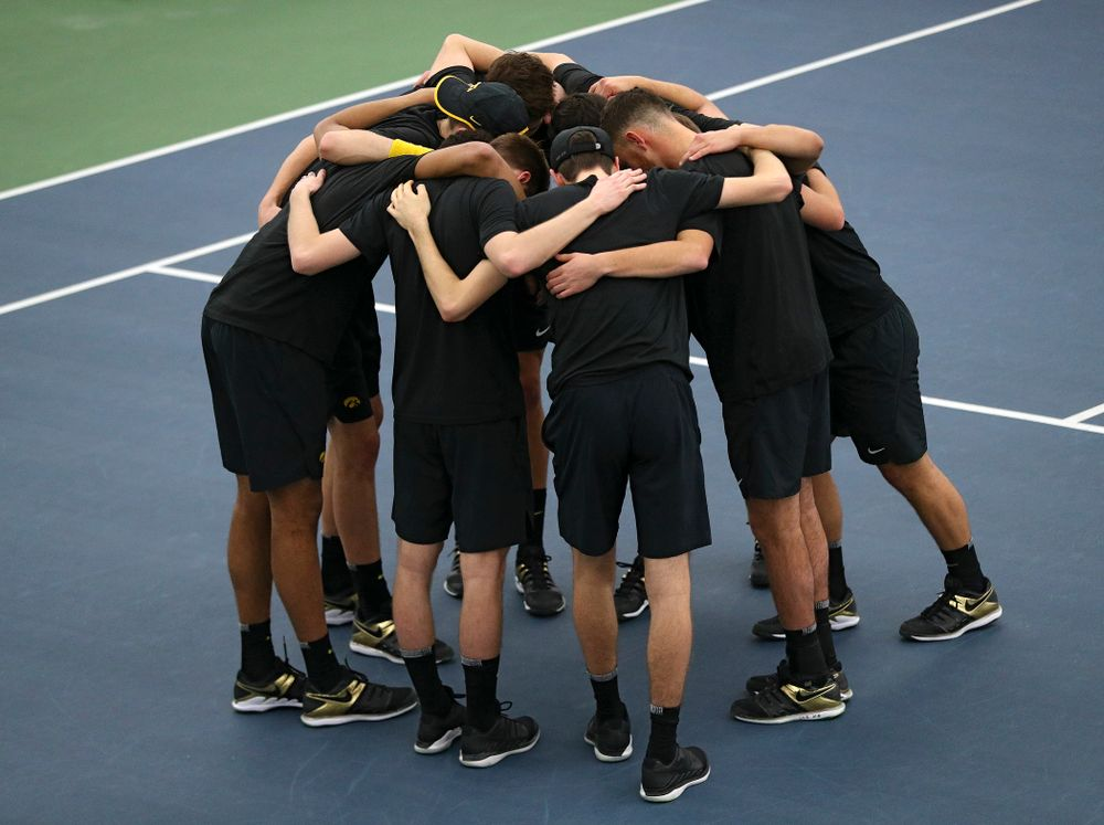 The Hawkeyes huddle before their match at the Hawkeye Tennis and Recreation Complex in Iowa City on Friday, March 6, 2020. (Stephen Mally/hawkeyesports.com)