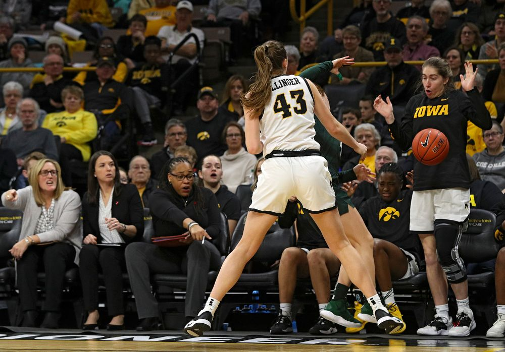 Iowa Hawkeyes forward Amanda Ollinger (43) pressures Michigan State Spartans guard Taryn McCutcheon (4) causing a turnover in front of the Iowa bench during the third quarter of their game at Carver-Hawkeye Arena in Iowa City on Sunday, January 26, 2020. (Stephen Mally/hawkeyesports.com)