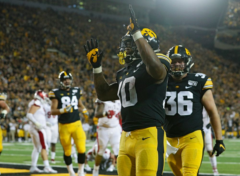 Iowa Hawkeyes running back Mekhi Sargent (10) celebrates after scoring a touchdown on a 2-yard run during the third quarter of their game at Kinnick Stadium in Iowa City on Saturday, Aug 31, 2019. (Stephen Mally/hawkeyesports.com)