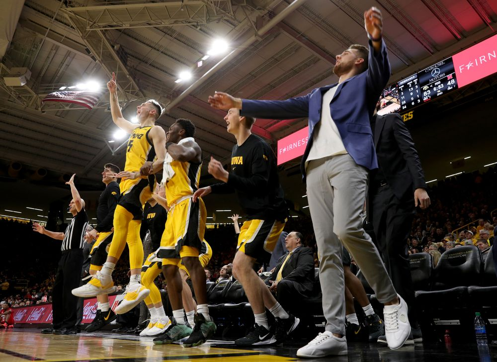 The Iowa Hawkeyes bench celebrates against the Nebraska Cornhuskers Saturday, February 8, 2020 at Carver-Hawkeye Arena. (Brian Ray/hawkeyesports.com)