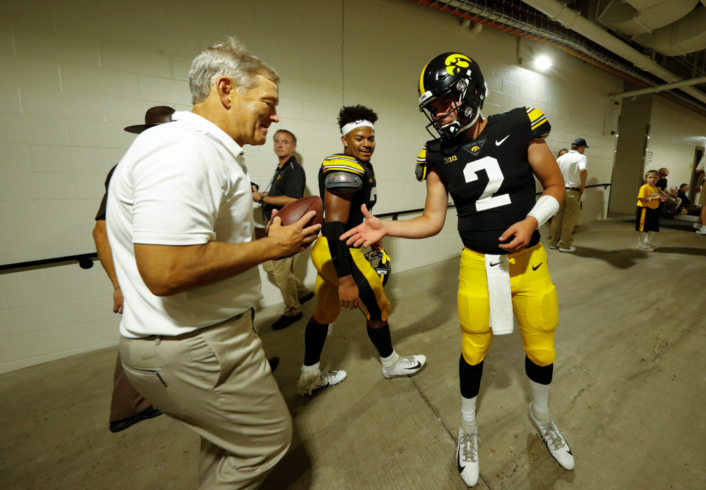 Iowa Hawkeyes quarterback Peyton Mansell (2) presents the ball from the final play against the Northern Illinois Huskies to head coach Kirk Ferentz Saturday, September 1, 2018 at Kinnick Stadium. (Brian Ray/hawkeyesports.com)