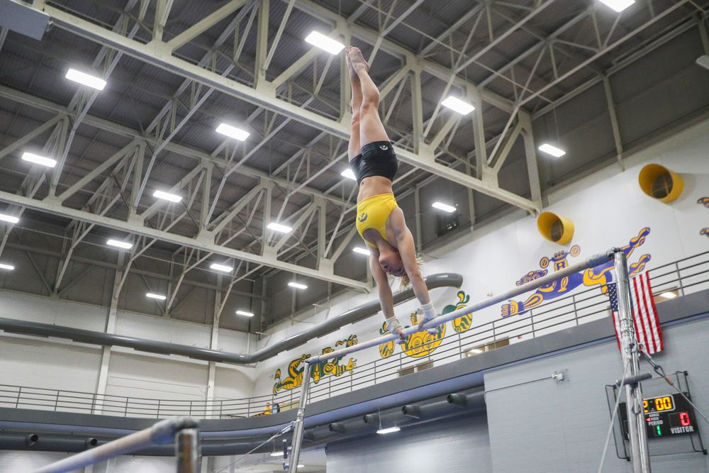 Alex Greenwald performs on the uneven bars during the Iowa women's gymnastics Black and Gold Intraquad Meet on Saturday, December 7, 2019 at the UI Field House. (Lily Smith/hawkeyesports.com)