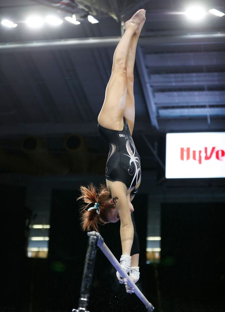 Iowa's Maria Ortiz competes on the bars against the Nebraska Cornhuskers