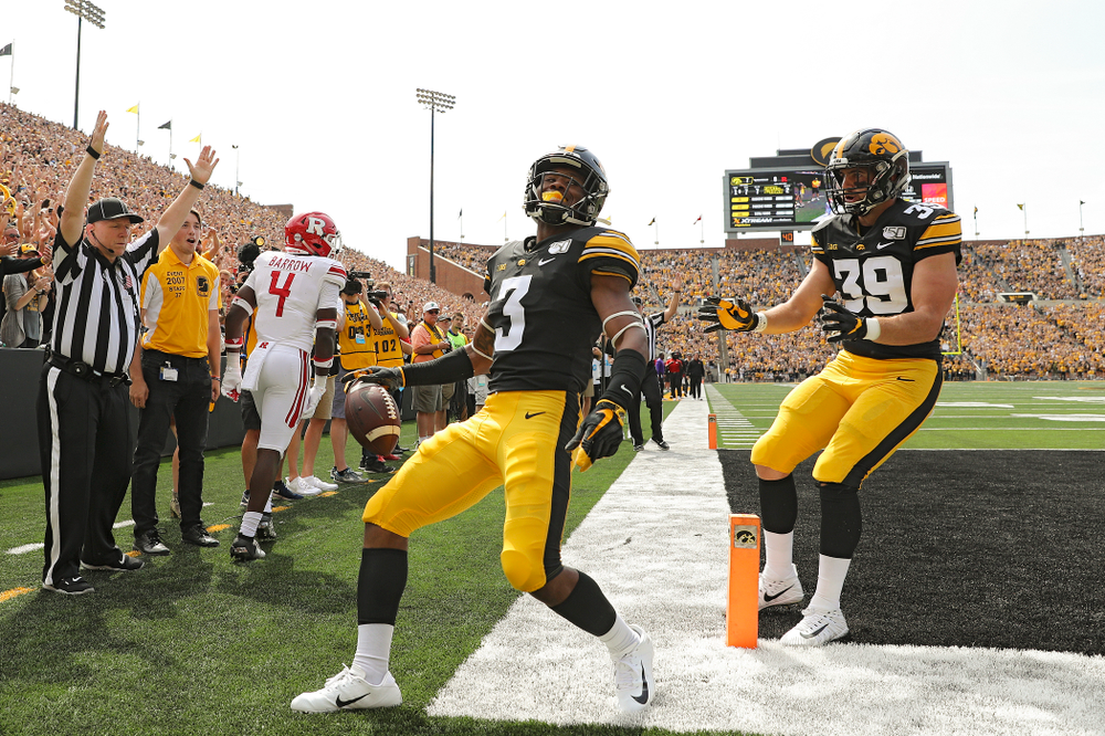 Iowa Hawkeyes wide receiver Tyrone Tracy Jr. (3) celebrates with tight end Nate Wieting (39) after his 7-yard touchdown reception during the second quarter of their Big Ten Conference football game at Kinnick Stadium in Iowa City on Saturday, Sep 7, 2019. (Stephen Mally/hawkeyesports.com)