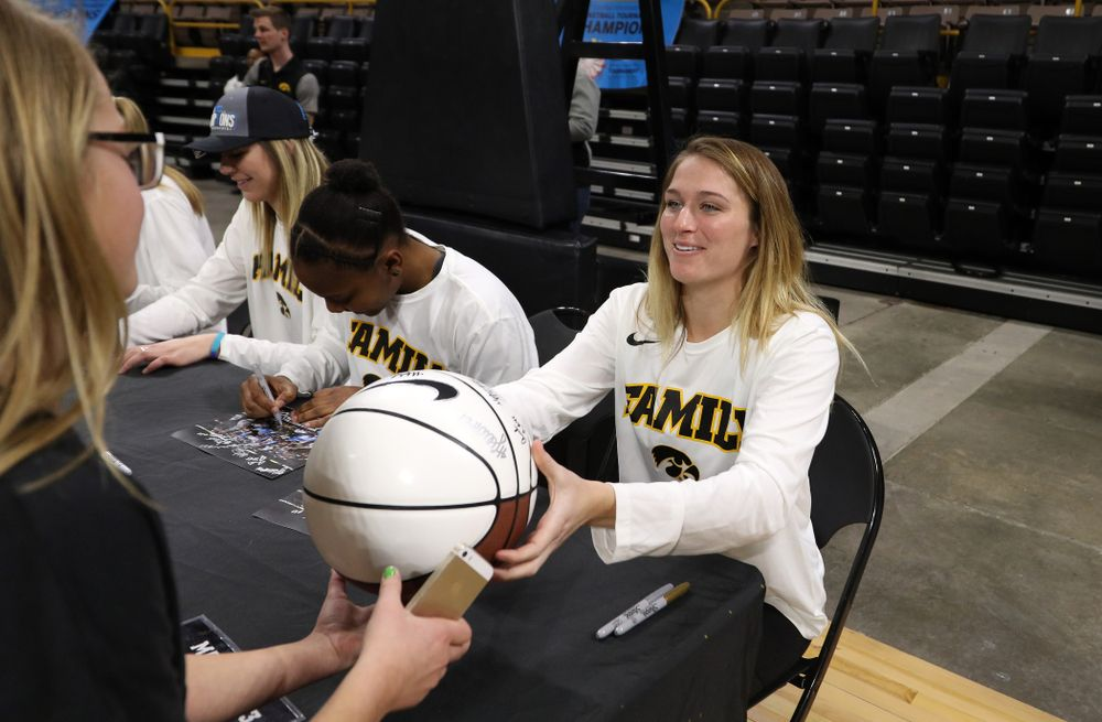 Iowa Hawkeyes guard Makenzie Meyer (3) signs autographs during a celebration of their Big Ten Women's Basketball Tournament championship Monday, March 18, 2019 at Carver-Hawkeye Arena. (Brian Ray/hawkeyesports.com)