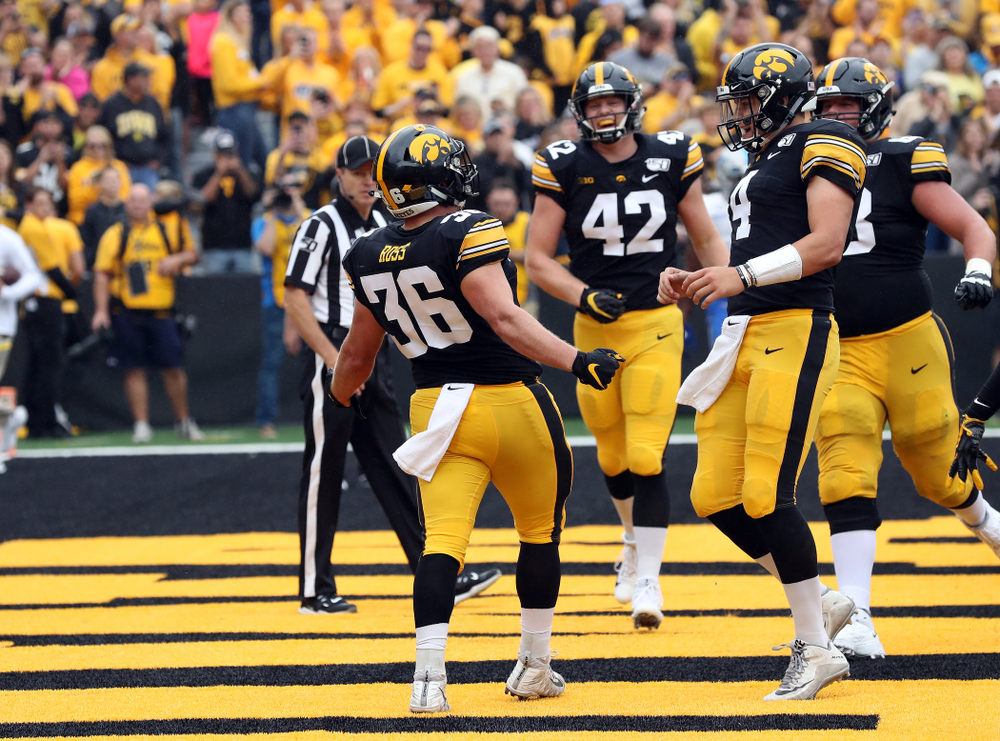 Iowa Hawkeyes fullback Brady Ross (36) celebrates with Iowa Hawkeyes quarterback Nate Stanley (4) after scoring a touchdown against Middle Tennessee State Saturday, September 28, 2019 at Kinnick Stadium. (Brian Ray/hawkeyesports.com)