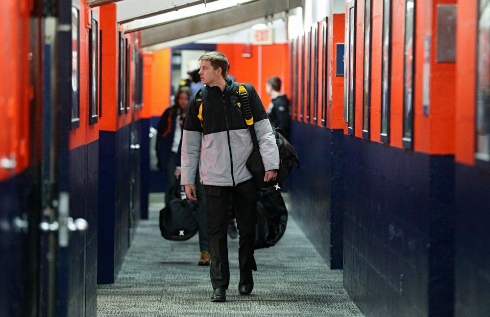 Iowa Hawkeyes guard Austin Ash (13) walks to the locker room as the team arrives before their ACC/Big Ten Challenge game at the Carrier Dome in Syracuse, N.Y. on Tuesday, Dec 3, 2019. (Stephen Mally/hawkeyesports.com)