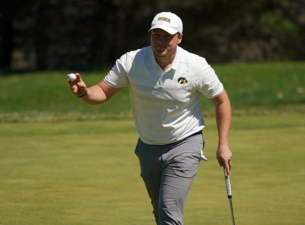 Iowa's Alex Schaake holds up his ball after finishing his first round of the Hawkeye Invitational at Finkbine Golf Course in Iowa City on Saturday, Apr. 20, 2019. (Stephen Mally/hawkeyesports.com)