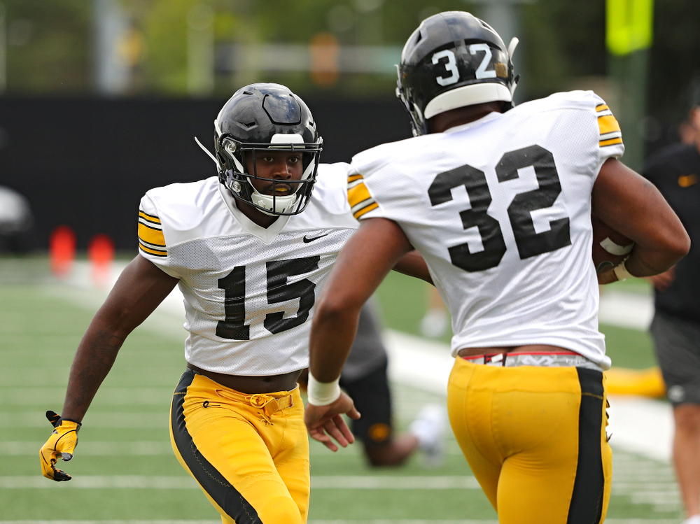 Iowa Hawkeyes defensive back Dallas Craddieth (15) closes in on linebacker Djimon Colbert (32) as they run a drill during Fall Camp Practice No. 10 at the Hansen Football Performance Center in Iowa City on Tuesday, Aug 13, 2019. (Stephen Mally/hawkeyesports.com)