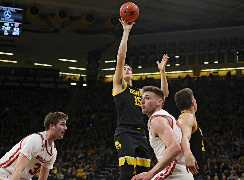 Iowa Hawkeyes forward Ryan Kriener (15) scores a basket during the first half of their game at Carver-Hawkeye Arena in Iowa City on Monday, January 27, 2020. (Stephen Mally/hawkeyesports.com)