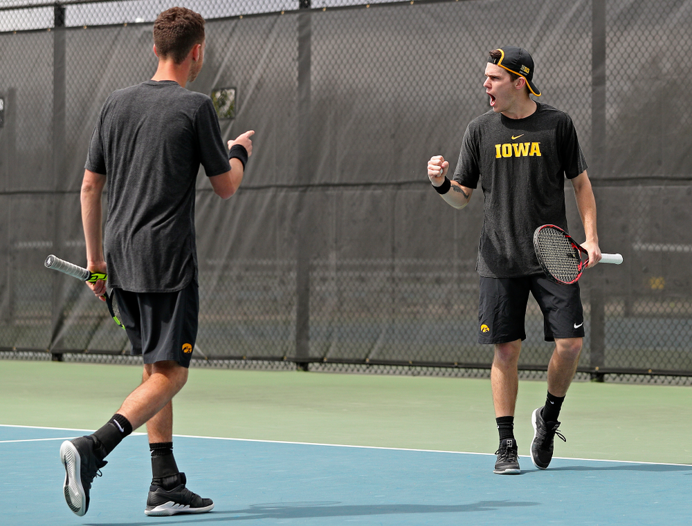 Iowa's Kareem Allaf (from left) points at Jonas Larsen as they celebrate a score during a double match against Ohio State at the Hawkeye Tennis and Recreation Complex in Iowa City on Sunday, Apr. 7, 2019. (Stephen Mally/hawkeyesports.com)