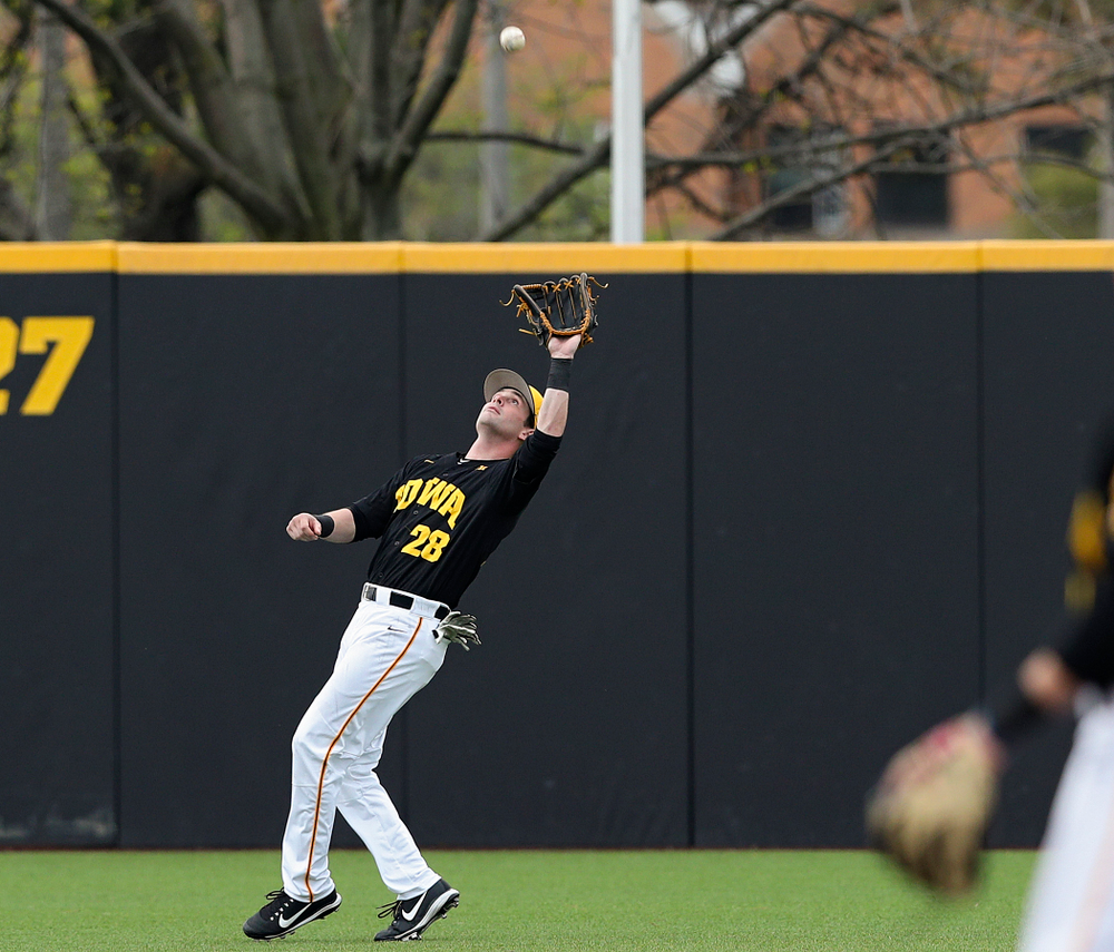 Iowa Hawkeyes left fielder Chris Whelan (28) pulls in a fly ball for an out during the first inning of their game against Western Illinois at Duane Banks Field in Iowa City on Wednesday, May. 1, 2019. (Stephen Mally/hawkeyesports.com)
