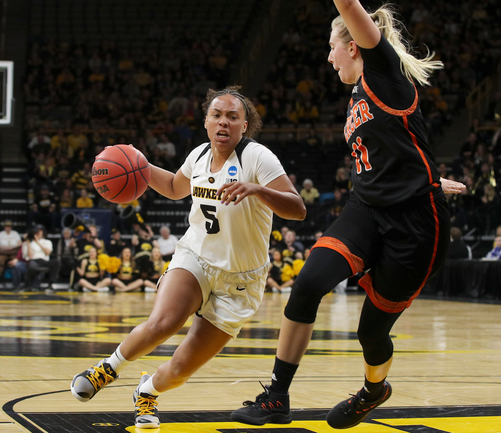 Iowa Hawkeyes guard Alexis Sevillian (5) drives in during the first round of the 2019 NCAA Women's Basketball Tournament at Carver Hawkeye Arena in Iowa City on Friday, Mar. 22, 2019. (Stephen Mally for hawkeyesports.com)