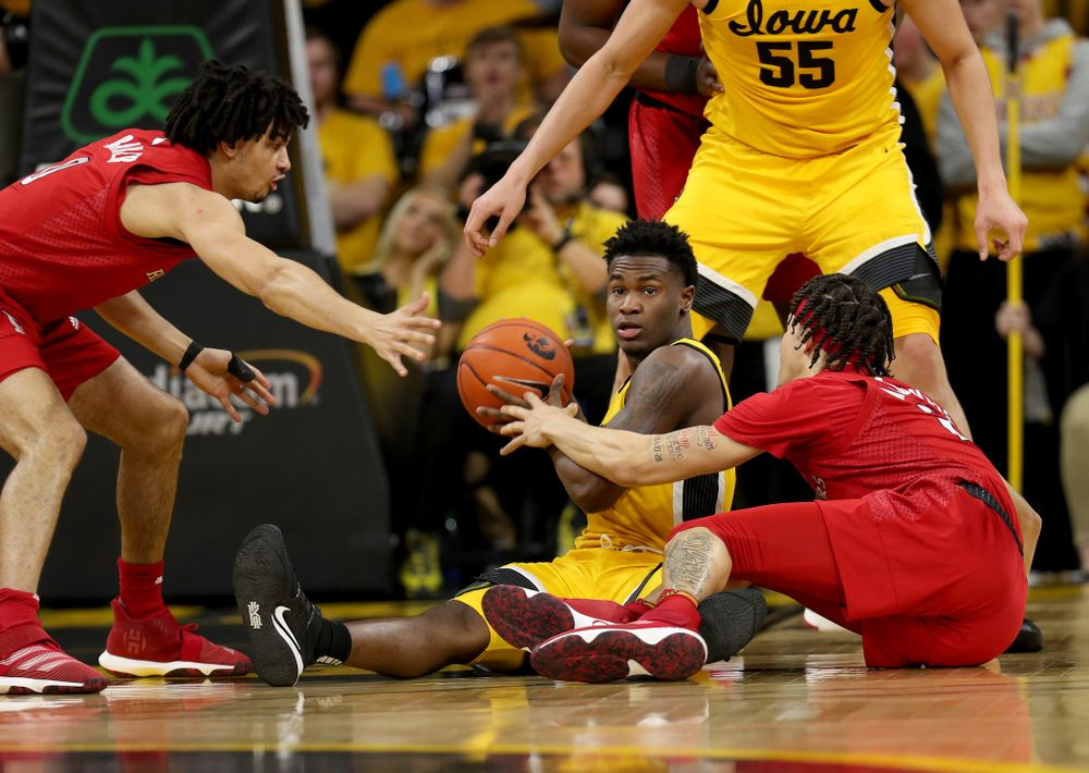 Iowa Hawkeyes guard Joe Toussaint (1) collects a loose ball against the Rutgers Scarlet Knights  Wednesday, January 22, 2020 at Carver-Hawkeye Arena. (Brian Ray/hawkeyesports.com)