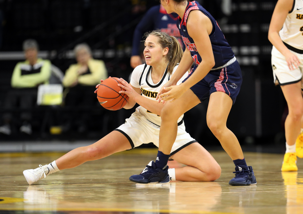 Iowa Hawkeyes guard Kathleen Doyle (22) steals the ball against Florida Atlantic University Thursday, November 7, 2019 at Carver-Hawkeye Arena. (Brian Ray/hawkeyesports.com)