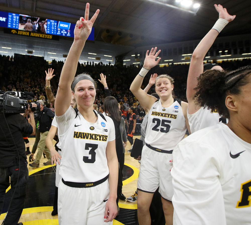 Iowa Hawkeyes guard Makenzie Meyer (3) points to the crowd after winning their game during the first round of the 2019 NCAA Women's Basketball Tournament at Carver Hawkeye Arena in Iowa City on Friday, Mar. 22, 2019. (Stephen Mally for hawkeyesports.com)