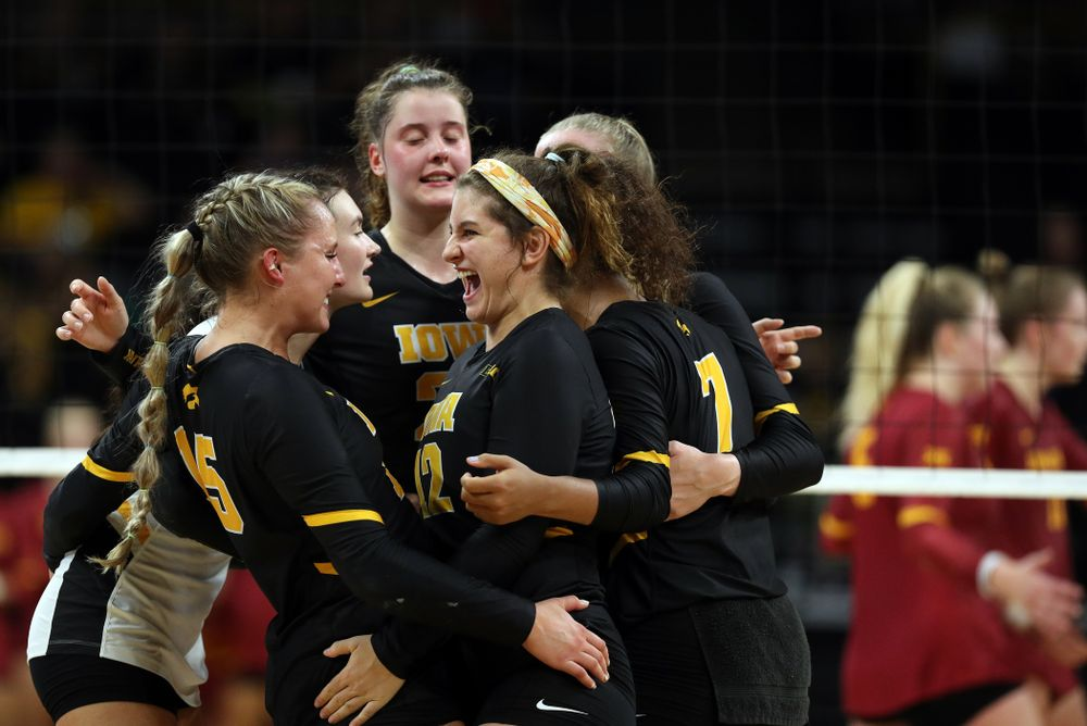 Iowa Hawkeyes defensive specialist Maddie Slagle (15) and defensive specialist Emily Bushman (12) celebrate a point against the Iowa State Cyclones Saturday, September 21, 2019 during the Iowa Corn Cy-Hawk Series Tournament at Carver-Hawkeye Arena. (Brian Ray/hawkeyesports.com)