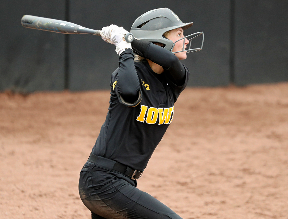 Iowa's Aralee Bogar (2) hits an RBI triple during the sixth inning of their game against Iowa Softball vs Indian Hills Community College at Pearl Field in Iowa City on Sunday, Oct 6, 2019. (Stephen Mally/hawkeyesports.com)