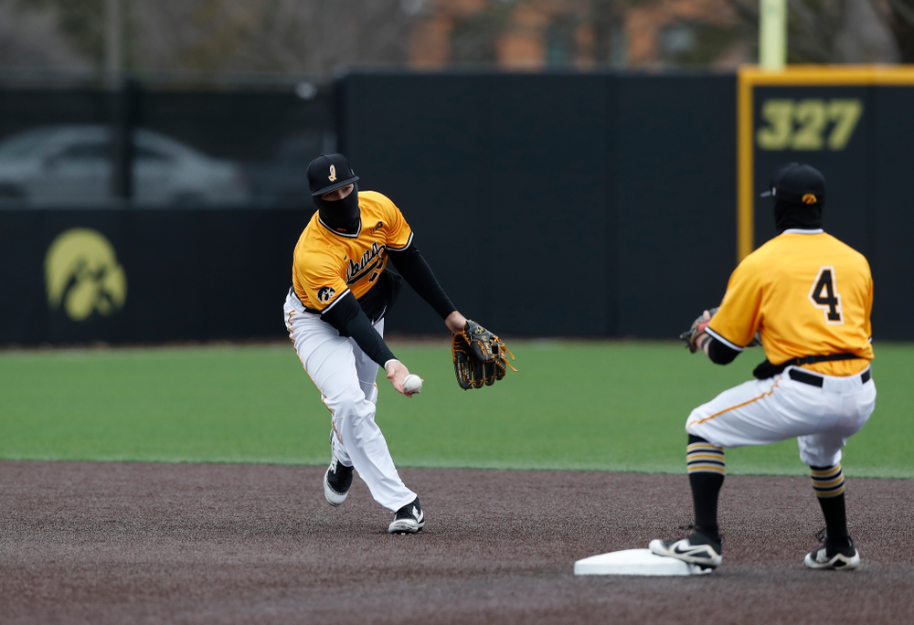 Iowa Hawkeyes infielder Kyle Crowl (23) and infielder Mitchell Boe (4) against the Ohio State Buckeyes Sunday, April 8, 2018 at Duane Banks Field.(Brian Ray/hawkeyesports.com)