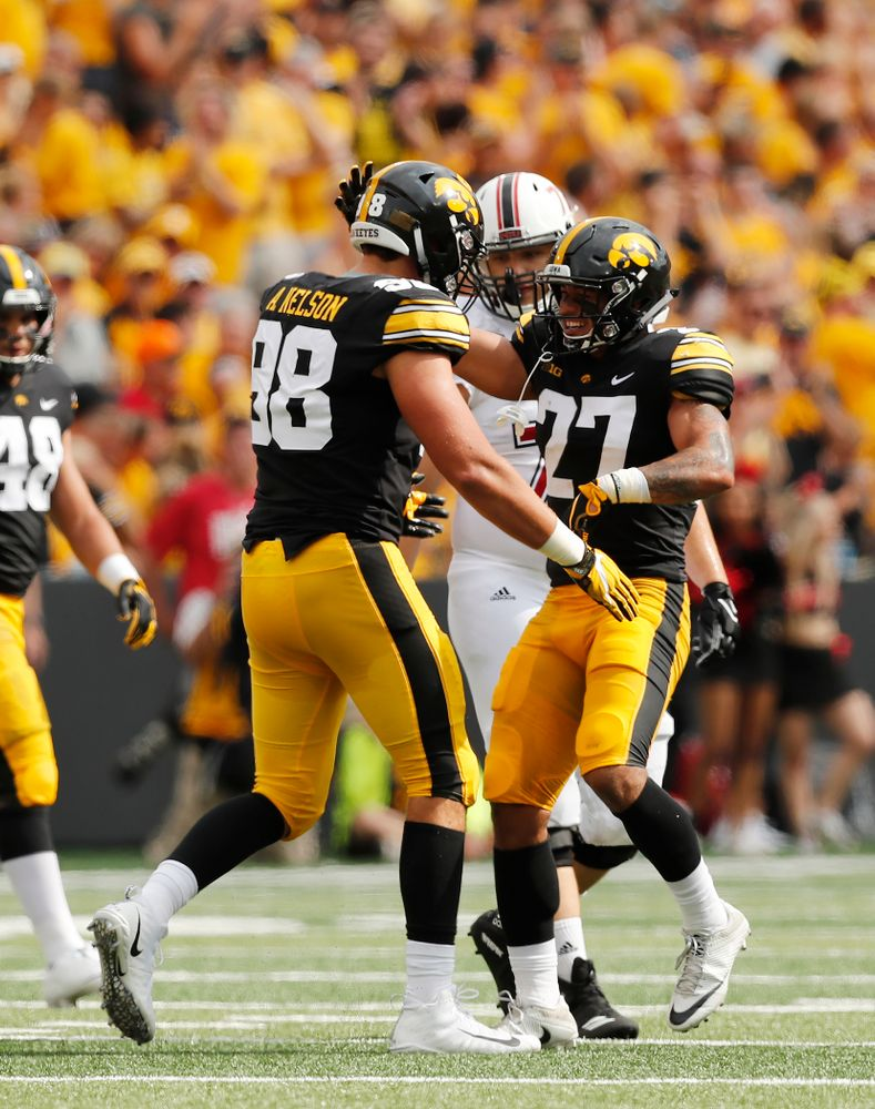 Iowa Hawkeyes defensive back Amani Hooker (27) and defensive end Anthony Nelson (98) against the Northern Illinois Huskies Saturday, September 1, 2018 at Kinnick Stadium. (Brian Ray/hawkeyesports.com)