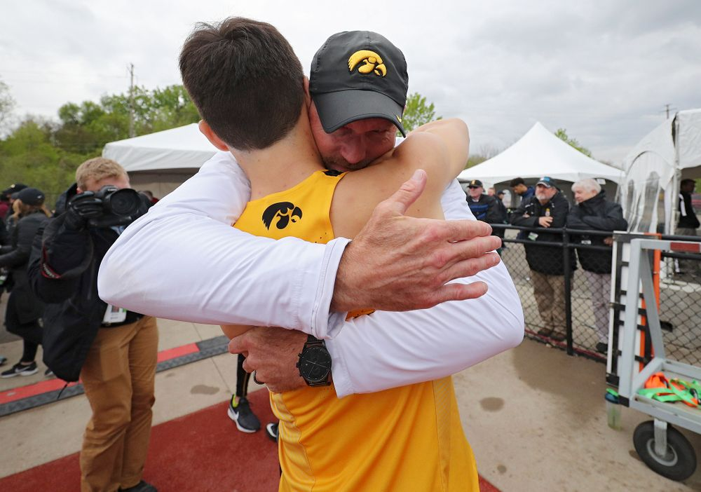 Iowa's Carter Lilly gets a hug from Director of Track and Field Joey Woody after they won the 1600 meter relay event on the third day of the Big Ten Outdoor Track and Field Championships at Francis X. Cretzmeyer Track in Iowa City on Sunday, May. 12, 2019. (Stephen Mally/hawkeyesports.com)